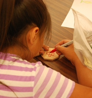 A girl working on a VBS craft project
