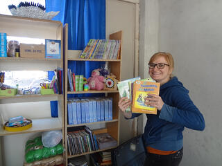 A missionary filling the church's brand-new library