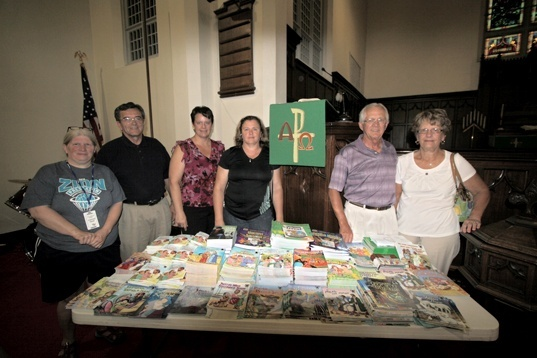 Chapel guests with the donated books