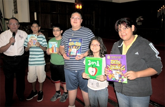 Gary with some of the students who received CGO books