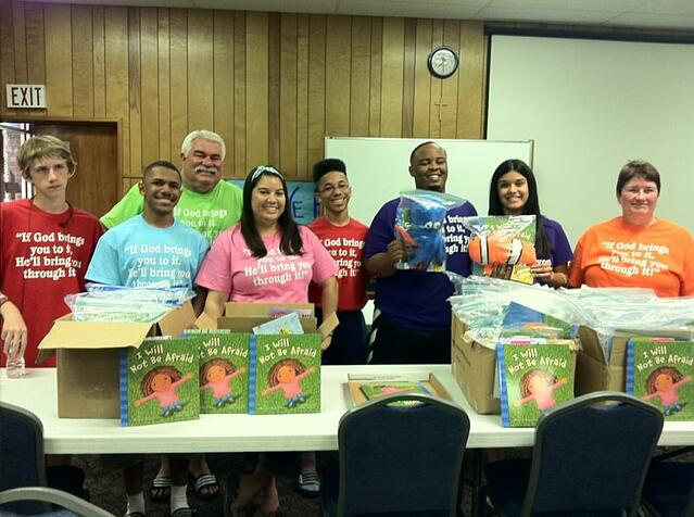 Volunteers packing donated books