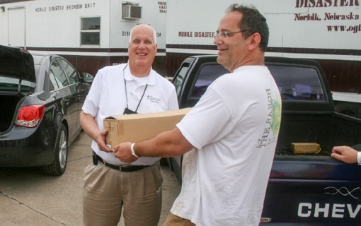 Volunteers delivering donated books from CGO