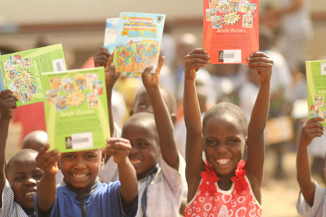 A celebration! The children were thrilled to receive their books.